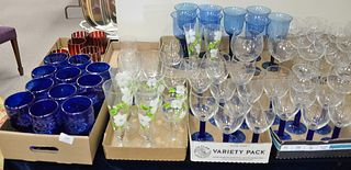 Eight Tray Lots of Glass Stemware, to include cranberry cut to clear goblets, cobalt blue etched glass stems, along with tall, blue glasses.