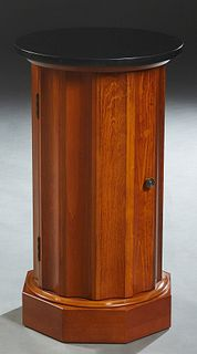 English Style Carved Birch Marble Top Columnar Cabinet, 20th c., the circular black marble over fluted sides with a door opening to a shelved interior