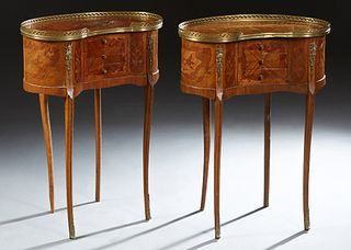 Pair of French Ormolu Mounted Louis XV Style Marquetry Inlaid Nightstands, early 20th c., of kidney form, the top with a pierced brass gallery, over t