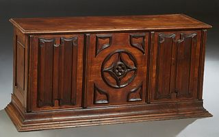 French Provincial Carved Mahogany Coffer, late 19th c., the lifting top over a front with an applied carved center panel, flanked by relief linenfold