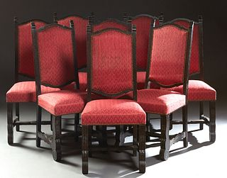 Set of Eight Spanish Carved Oak Upholstered Dining Chairs, 20th c., the arched backs over upholstered seats on thick cabriole legs joined by shaped st