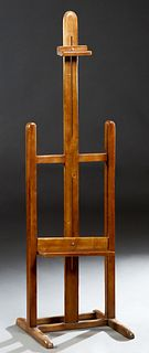 French Carved Beech Adjustable Artist's Easel, 19th c., on trestle supports, joined by square stretchers, H.- 68 in., W.- 20 in., D.- 20 in.