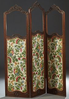 Louis XV Style Carved Walnut Three Panel Dressing Screen, late 19th c., each arched panel with a C-scroll and floral carved crest over a previously gl