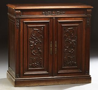 Diminutive French Provincial Henri II Style Carved Walnut Sideboard, c. 1880, the rounded edge top over two cupboard doors with applied carving, flank