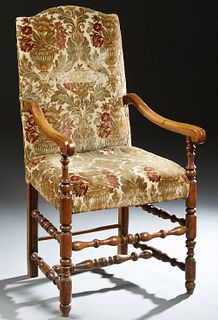French Louis XIII Style Carved Elm Fauteuil, 19th c., the arched canted rectangular back over scrolled arms, to a cushioned seat, on turned tapered le