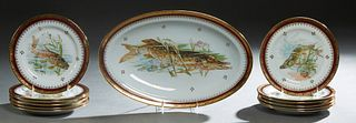 French Limoges Thirteen Piece Porcelain Fish Set, early 20th c., consisting of 12 circular plates and a long oval platter, early 20th c., with gilt ri