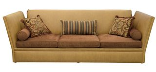 Edward Ferrell Sofa, having Knole drop ends with tassels, upholstered in tan ostrich skin with brown upholstered cushions, height 46 inches, length 12