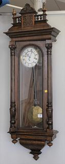 Regulator Clock having walnut case, enameled dial and brass works.