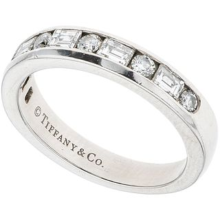 HALF ETERNITY RING WITH DIAMONDS IN  .950 PLATINUM, TIFFANY & CO. 11 brilliant and baguette cut diamonds ~0.64 ct. Size: 6