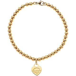 18K YELLOW GOLD BRACELET, TIFFANY & CO., RETURN TO TIFFANY COLLECTION Weight: 8.6 g. Length: 17.5 cm
