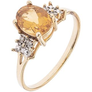 RING WITH CITRINE AND DIAMONDS IN 14K YELLOW GOLD Citrine oval cut ~1.0 ct and 4 8x8 cut diamonds~0.04 ct. Size: 7 ¼