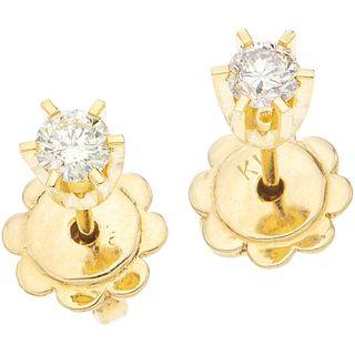 "PAIR OF STUD EARRINGS WITH DIAMONDS, 14K YELLOW GOLD 2 Brilliant cut diamonds ~0.24 ct. Weight: 1.8 g. Diameter: 0.15"" (0.4 cm)"