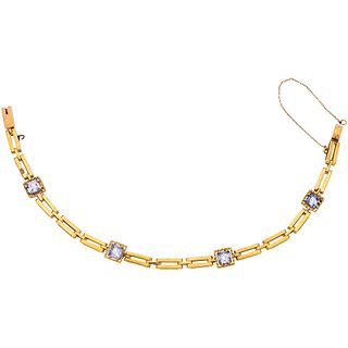 18K YELLOW GOLD BRACELET WITH SIMULANTS Weight: 8.7 g. Length: 16.0 cm
