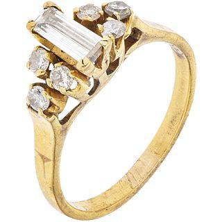 18K YELLOW GOLD RING WITH DIAMONDS 1 Trapezoid baguette cut diamonds ~0.35 ct and 6 Brilliant cut diamonds ~0.30 ct