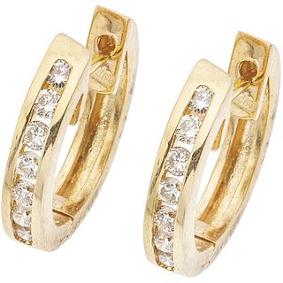 """PAIR OF 14K YELLOW GOLD EARRIGNS WITH DIAMONDS 14 Brilliant cut diamonds ~0.56 ct. Weight: 5.2 g. Size: 0.1 x 0.6"""" (0.3 x 1.7 cm)"""