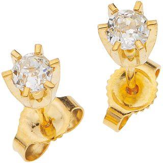 "PAIR OF STUD EARRINGS WITH DIAMONDS, 14K YELLOW GOLD 2 Antique cut diamonds ~0.28 ct. Weight: 0.8 g. Diameter: 0.15"" (0.4 cm)"