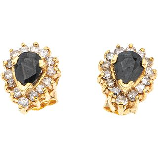 PAIR OF STUD EARRINGS WITH SAPPHIRES AND DIAMONDS IN 14K YELLOW GOLD 2 Pear cut sapphires~1.20ct, 28 Diamonds (different cuts) ~0.70ct
