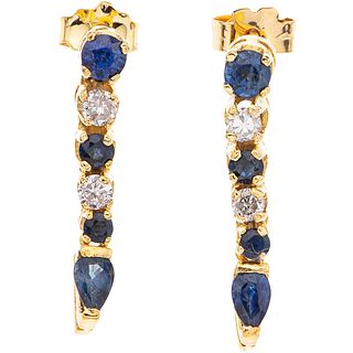 PAIR OF EARRINGS WITH SAPPHIRES AND DIAMONDS IN 14K YELLOW GOLD 8 Round and pear cut sapphires ~0.70 ct, 4 Brilliant cut diamonds