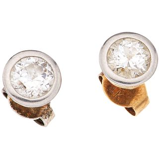 PAIR OF STUD EARRINGS WITH DIAMONDS IN 18K YELLOW GOLD 2 Antique cut diamonds ~1.20 ct. Clarity: SI2-I2. Color: I-J