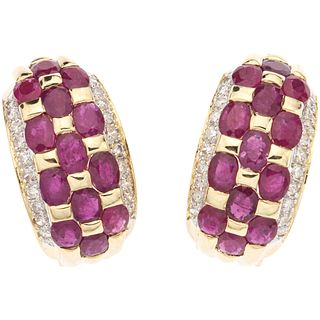 PAIR OF EAARRINGS WITH RUBIES AN DIAMONDS IN 14K YELLOW GOLD 26 Oval cut rubies ~3.90 ct, 40 Brilliant cut diamonds ~0.57 ct
