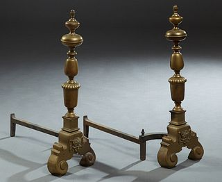 Pair of Large Continental Brass Andirons, 20th c., with acorn finial tops on knopped supports, to a large reeded urn support, on a scrolled trestle ba