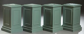 Set of Four Polychromed Carved Birch Pedestals, 20th c., the stepped square top over paneled sides, to a stepped square base, now in muted green paint
