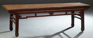 Chinese Red Lacquer Daybed, 19th c., with a woven rattan top over pierced skirts, on block legs, H.- 21 in., W.- 67 1/2 in., D.- 20 in.