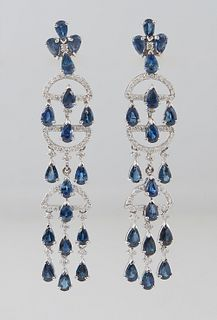 Pair of 14K White Gold Pendant Sapphire Earrings, the pear shaped cruciform sapphire stud with a diamond center, issuing links with pear shaped sapphi