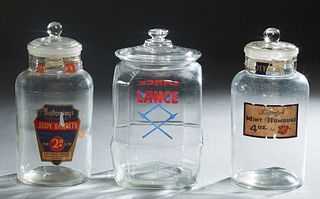"""Three Glass Countertop Advertising Jars, 20th c., one for """"Bottomley's Mint Humbugs""""; one for Lance products; and one for """"Bottomley's Judy Barrets,"""""""