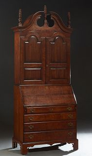 American Georgian Style Carved Mahogany Breakfront Secretary Bookcase, 20th c., by the Wright Furniture Co., the broken arch pediment with three corks