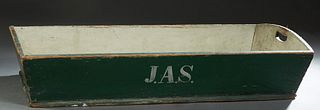 "Louisiana Carved and Polychromed Pine Harvesting Basket, 19th c., the short sides with hand holes, in green paint, with ""JAS"" initials painted on one"
