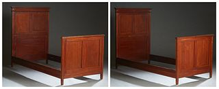 Pair of English Edwardian Inlaid Mahogany Beds, c. 1910, the stepped crown above a paneled high back, to inlaid mahogany rails and a short paneled foo