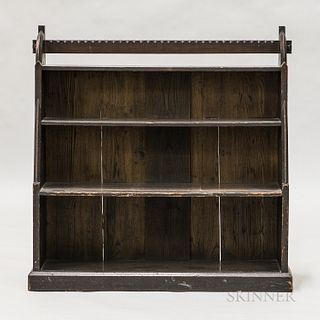 Small Gothic-style Arts and Crafts Oak Bookcase, early 20th century, four graduated shelves supported by sides with stepped, sloped and curved edges,