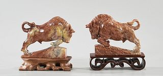 Two Carved Soapstone Bulls