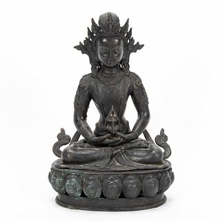 SINO-TIBETAN PATINATED FIGURE OF A SEATED AMITHAY