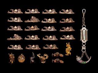 26 Mixed Metal Menuki and A Silver Flask Pendant