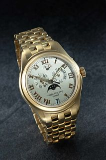 PATEK PHILIPPE, 18K YELLOW GOLD REF. 5036/1J-001 ANNUAL CALENDAR WITH MOON PHASE WRISTWATCH