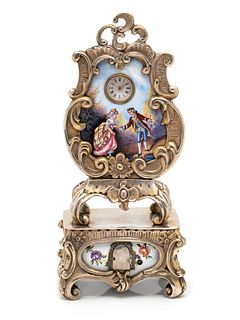 GILT-METAL AND ENAMEL CLOCK WITH HIDDEN AUTOMATON