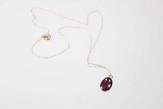 Janus Pendant with Red Sapphire