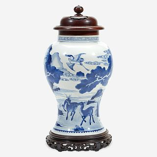 A Chinese blue and white porcelain vase with carved wood cover and stand The vase Kangxi period