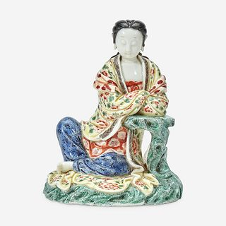 A Chinese enameled Dehua porcelain figure of Guanyin seated 18th Century, later decorated