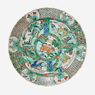 """A Chinese famille verte-decorated """"Mythical Beasts"""" porcelain charger Kangxi period"""