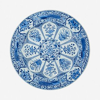 """A large Chinese blue and white """"Peacock and Rosette"""" charger Kangxi period"""
