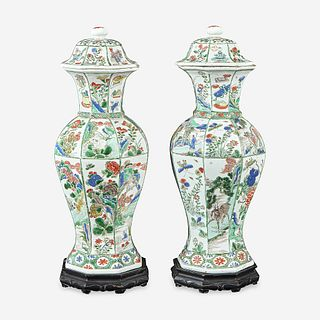 A pair of Chinese famille verte-decorated octagonal baluster vases and covers Kangxi period