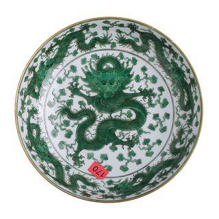A CHINESE WHITE-GROUND GREEN GLAZED 'DRAGON' DISH