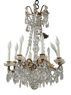 Eight Light Crystal and Brass Chandelier, height 28 inches, diameter 18 inches.
