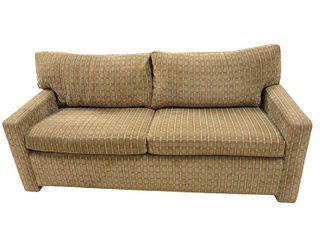Upholstered Two Cushion Sleeper Sofa.