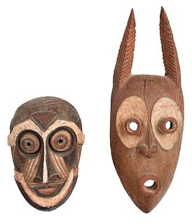 Two African Carved and Paint Decorated Masks