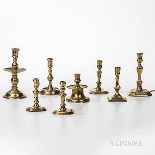 Eight Early Brass Candlesticks
