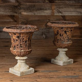 Pair of Pierced Cast Iron Trellis and Campagna Form Urns on Stone Bases